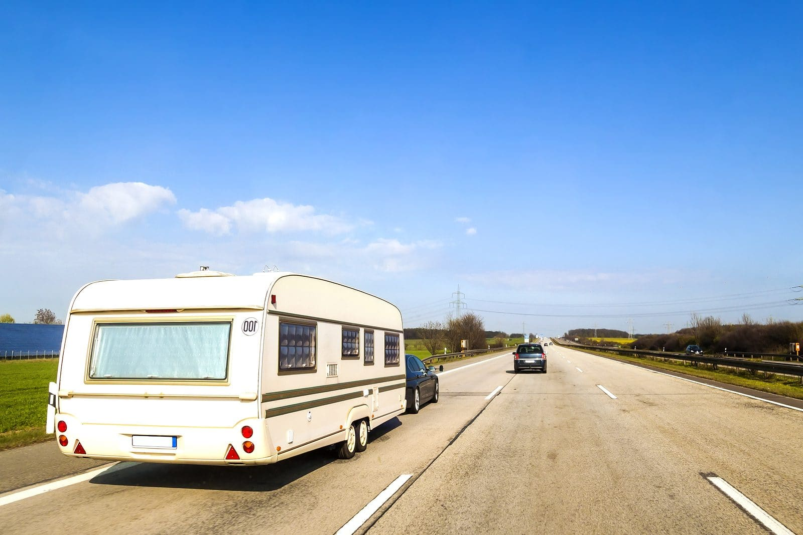 Caravan Or Recreational Vehicle Motor Home Trailer On A Freeway