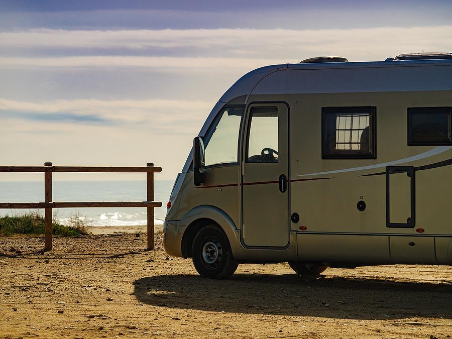 Camper Rv Caravan On Mediterranean Coast In Spain. Wild Camping